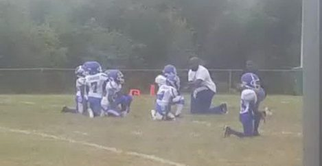 Team of 8-year-old football players kneel in protest during National Anthem