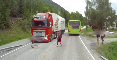 Dashcam footage of semi-truck narrowly missing kids is heart-stopping