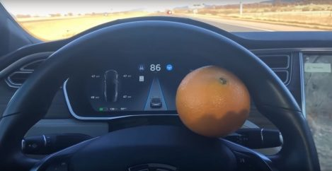 This guy used an orange to hack his Tesla into a self-driving car