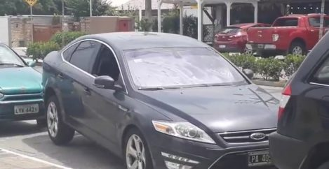 Driver uses some sort of dark magic to get out of a parking spot.