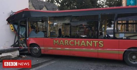 Four hurt as bus crashes into house