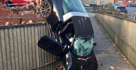 73-year-old survives crash through brick wall and down 10-foot drop